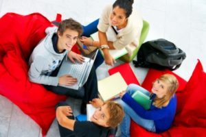 teens sitting together studying