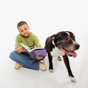 boy reading to dog