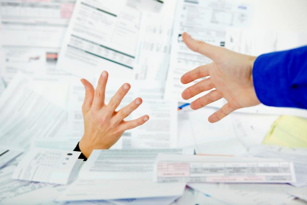 tax forms and hands