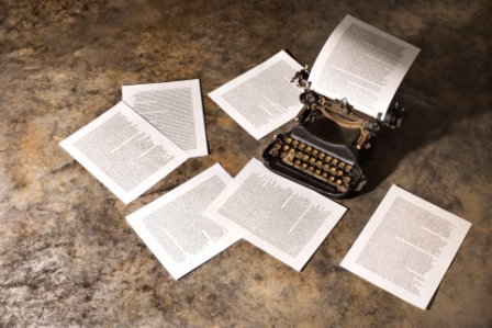 typerwriter with scattered papers