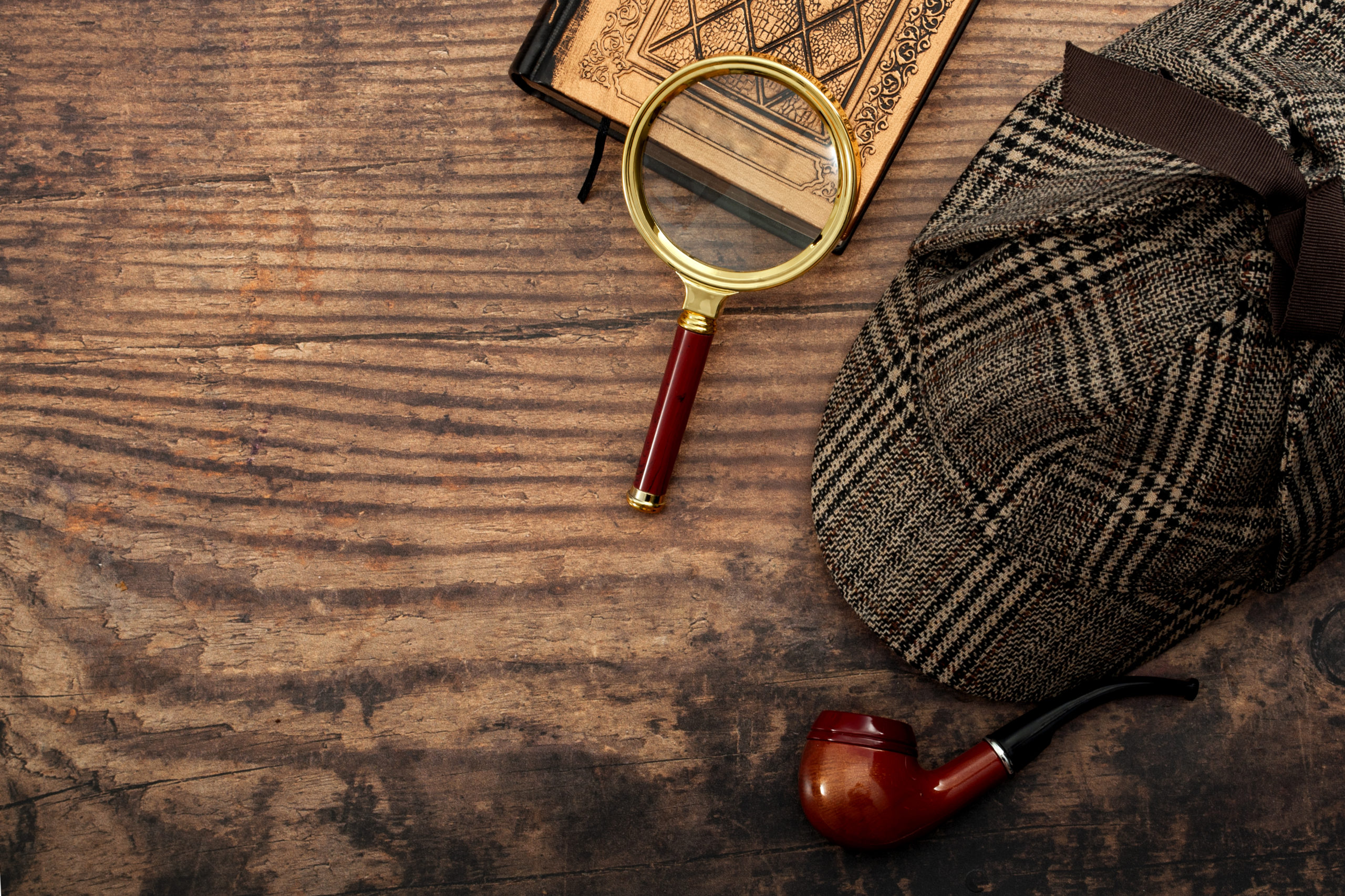 Magnifying Glass, Pipe, Cap, And Book