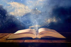 Open Book With Magical Swirls Of Light Coming Out
