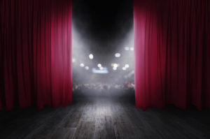 curtains opening on a stage