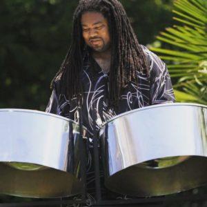 man playing steel drums