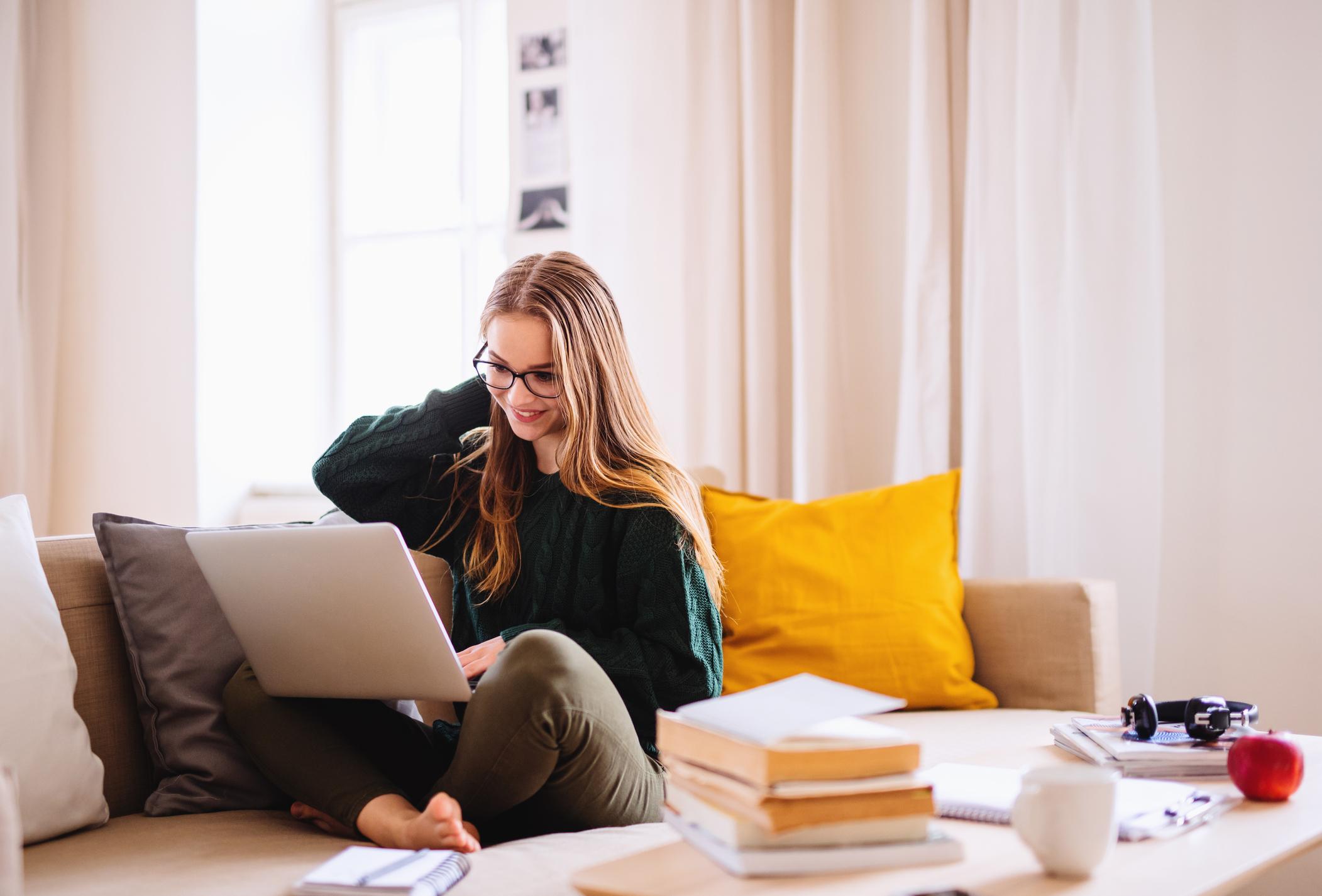 teen girl using a laptop