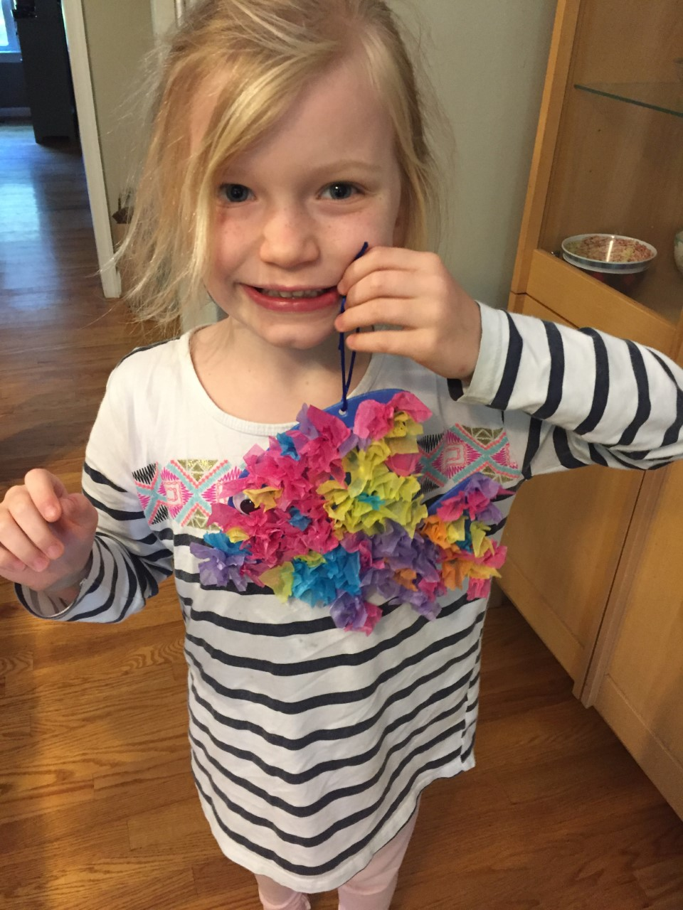 Little girl with craft fish