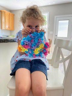 child with craft fish