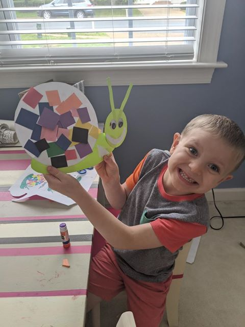boy with snail craft