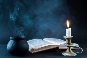 Book with Candle and Cauldron
