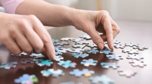 Person Doing Puzzle