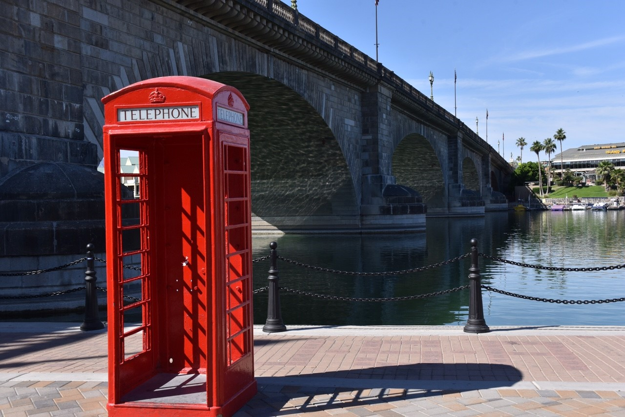 Phone Booth In Front Of London Bridge