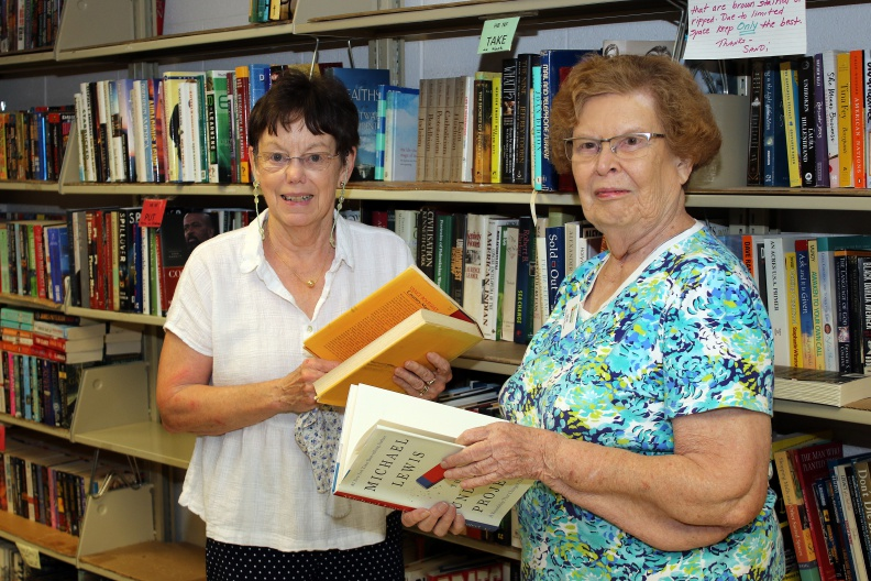 two women holding books